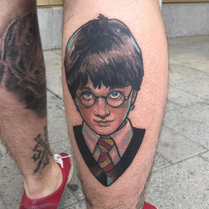 Nice looking colored very detailed portrait on leg tattoo of Harry Potter