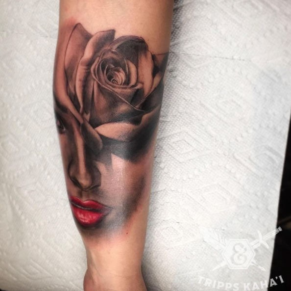 Nice looking detailed rose flower tattoo on forearm combined with mystical woman portrait