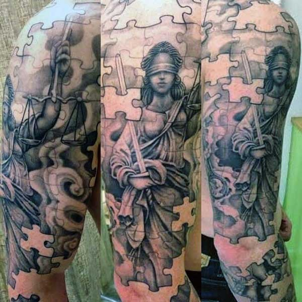 Nice looking puzzle picture like black ink sleeve tattoo of Justice statue