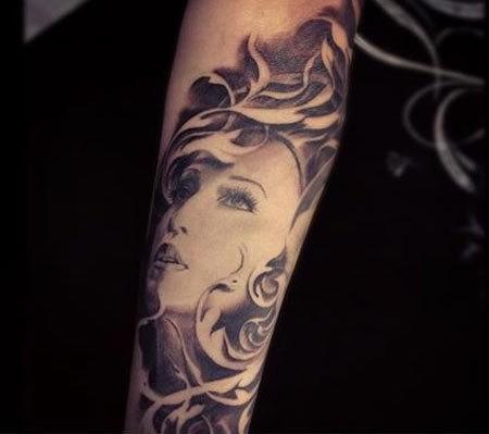 Nice madonna forearm tattoo