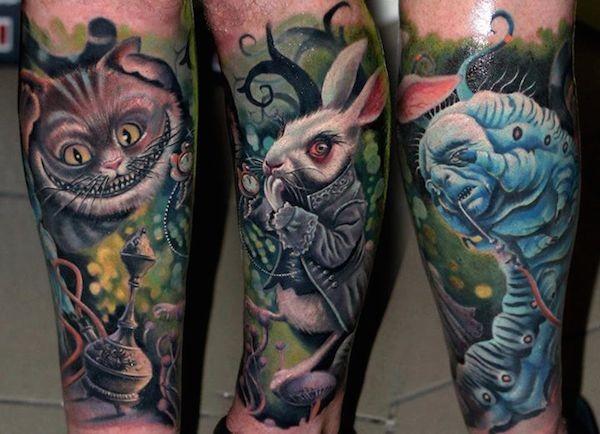 Nice multicolored detailed forearm tattoo of various Alice in wonderland heroes