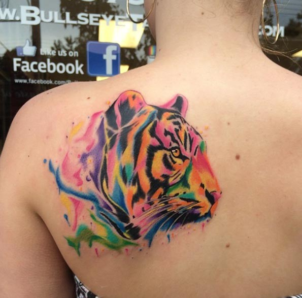 Nice multicolored natural looking tiger tattoo on shoulder