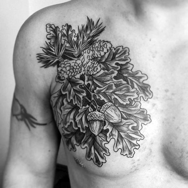 Nice natural looking black and white leaves tattoo on chest