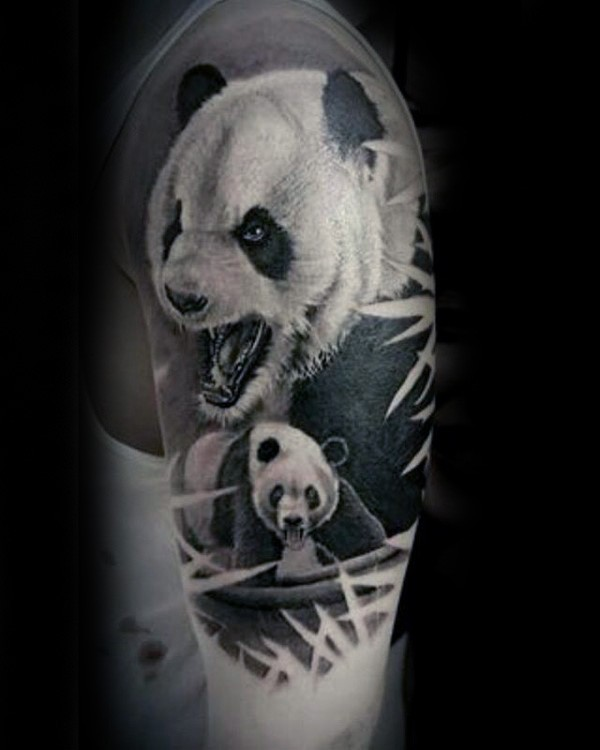nice natural looking colored shoulder tattoo of big panda bears