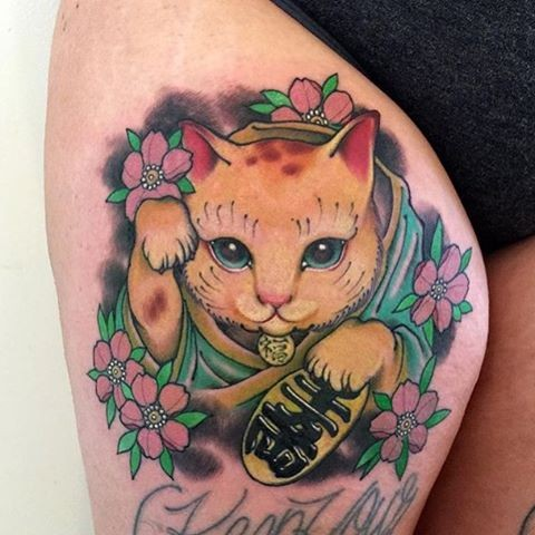 Nice new school style colored thigh tattoo of maneki neko japanese lucky cat with flowers and lettering