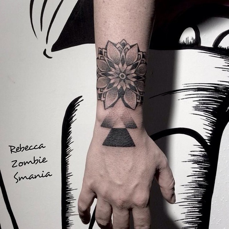 Nice painted black and white flower with geometrical figure tattoo on wrist