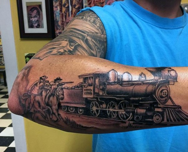 Nice painted black ink old western train with cowboys tattoo on arm