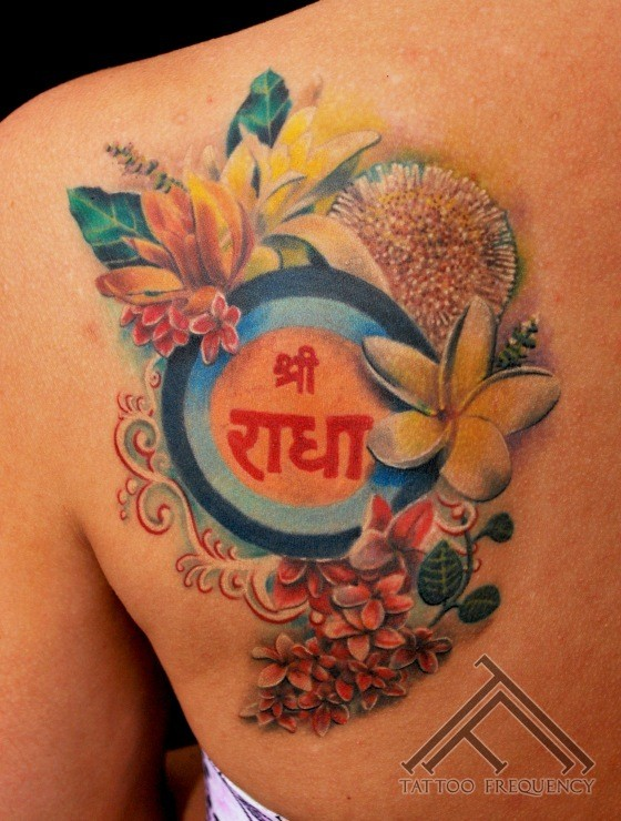 Nice painted colorful various flowers tattoo on shoulder with lettering