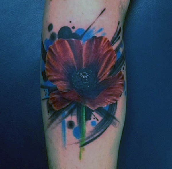 Nice painted little colored flower tattoo on arm