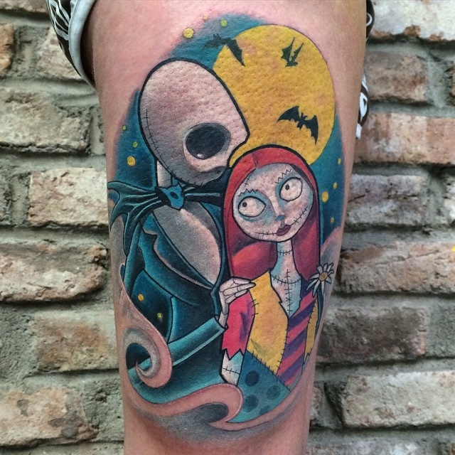 Nice painted multicolored monster couple tattoo on thigh with yellow moon