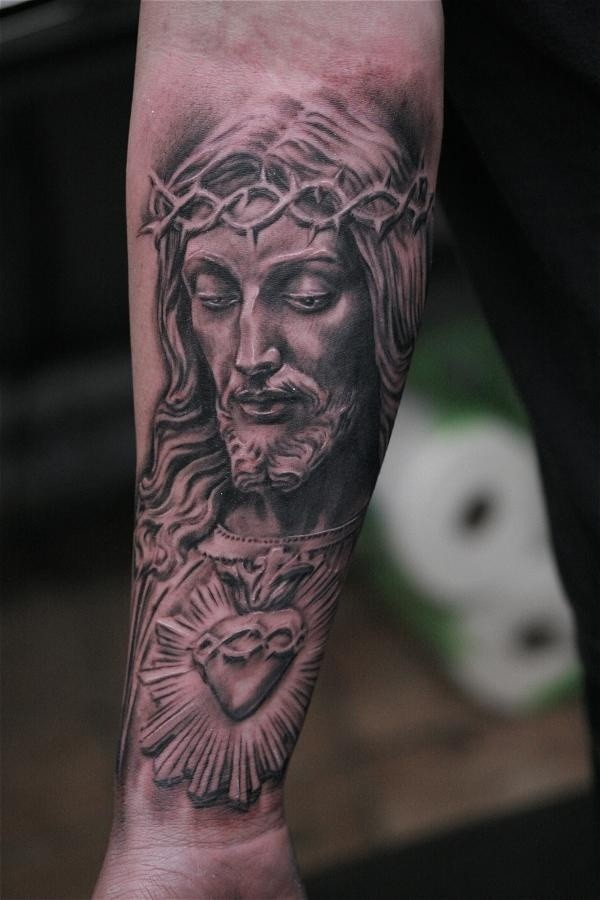 Nice portrait of jesus in a crown of thorns forearm tattoo
