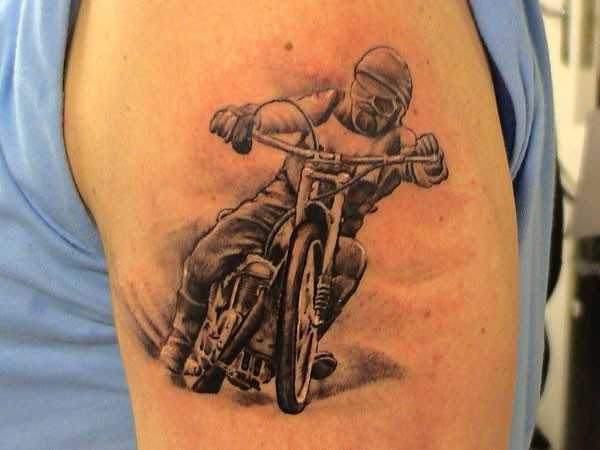 Nice racer on a motorcycle tattoo on shoulder