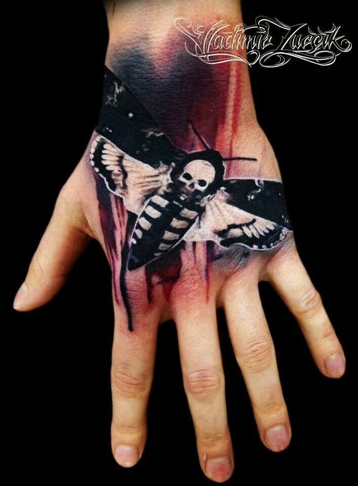 Nice real photo like 3D night butterfly tattoo on hand stylized with white skull
