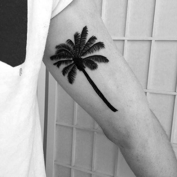 Nice realistic detailed palm tree tattoo on biceps