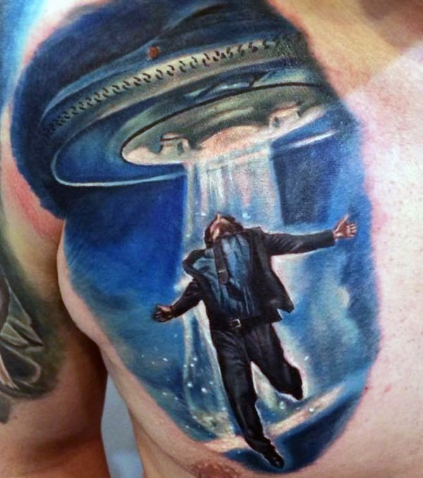 Nice realistic looking colored aliens stealing human tattoo on chest