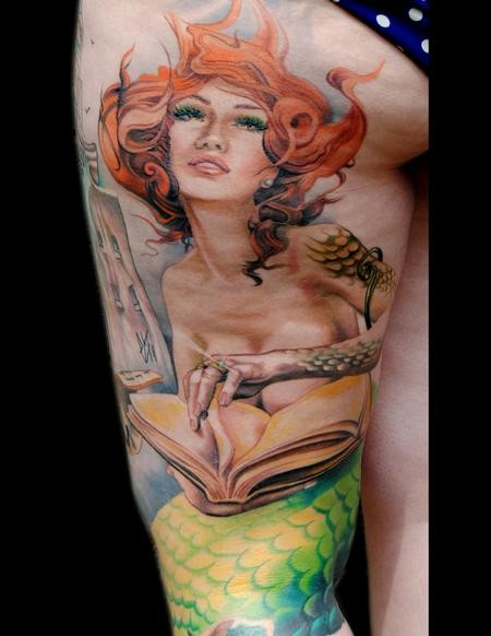 Nice redhead mermaid with book tattoo on thigh
