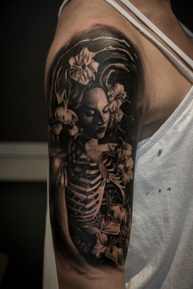 Nice skeleton woman in flowers tattoo on shoulder