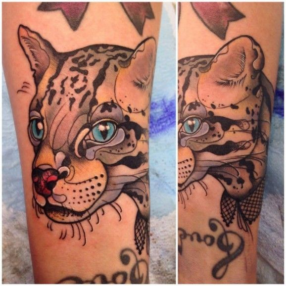 Nice watercolor head of a wild cat tattoo by Katie Sho
