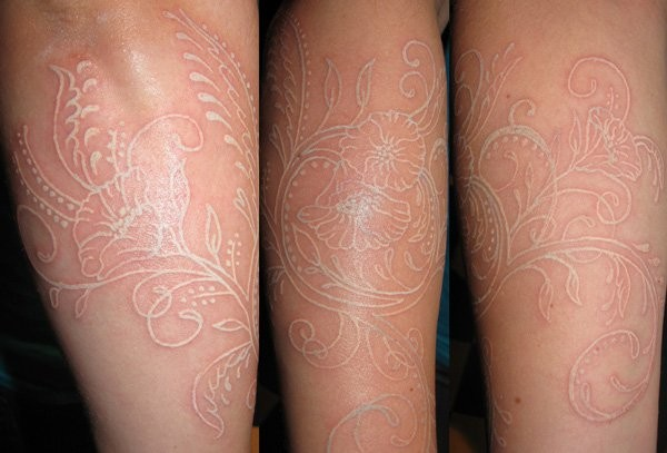 Nice white ink flowers tattoo