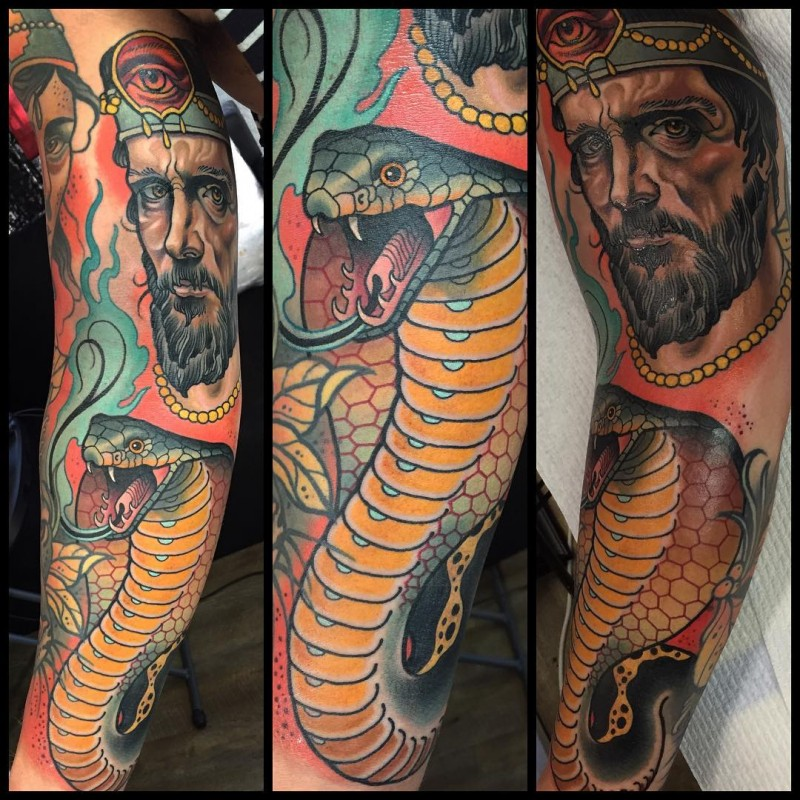Noe traditional style colored sleeve tattoo of human face with big snake