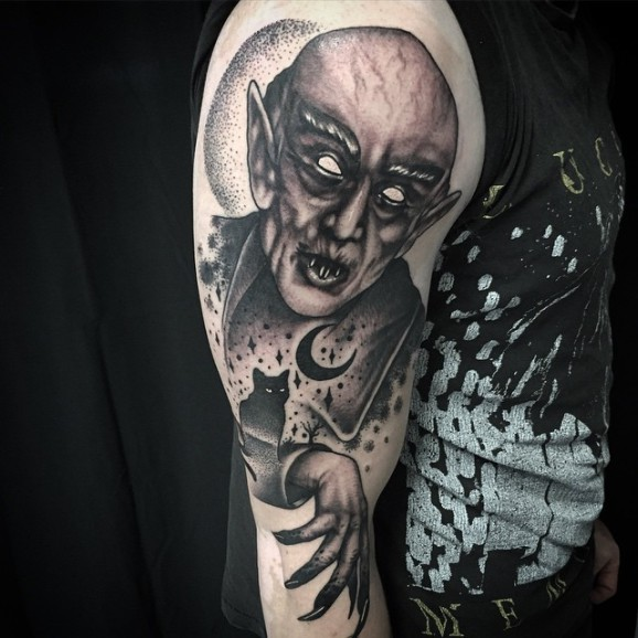 Nosferatu with black cat vampire tattoo on half sleeve for Vampire skull tattoo