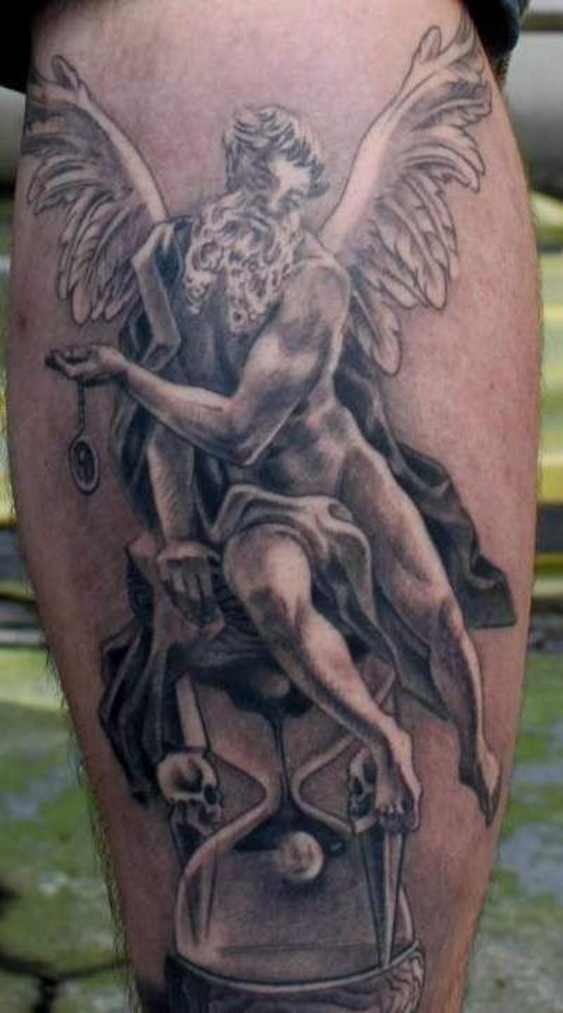 Old angel tattoo on leg