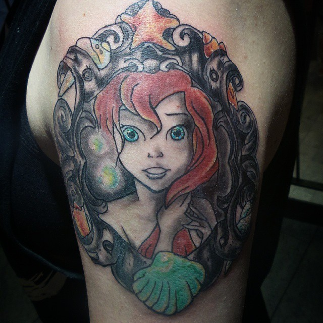 Old cartoon Ariel mermaid portrait tattoo on upper arm