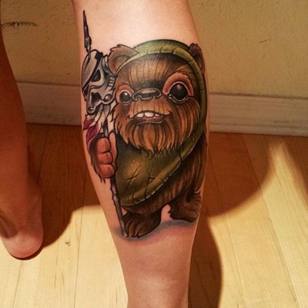 Old cartoon like 3D colored ewok tattoo on leg with storm troopers helmet