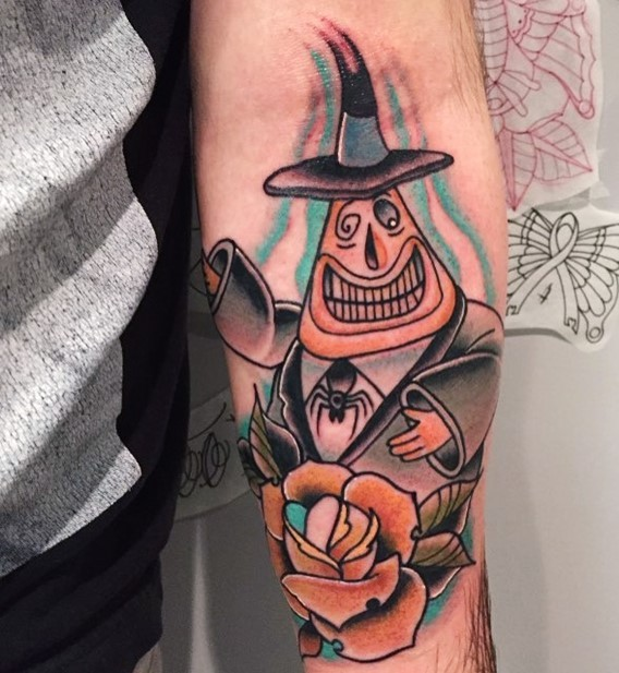 Old cartoon like colored funny gentleman ghost tattoo on forearm combined with beautiful rose