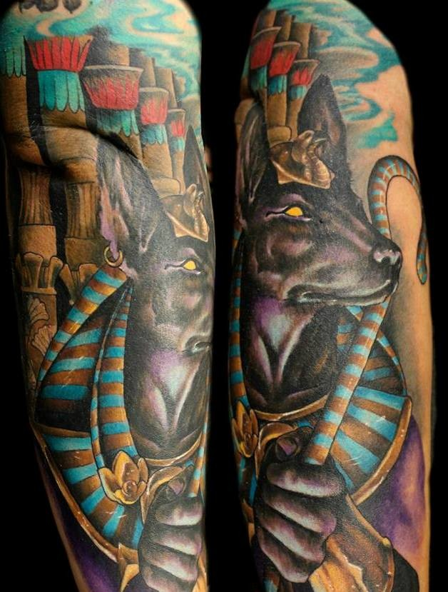 Old cartoon like colored sleeve tattoo of Egypt God Anubis