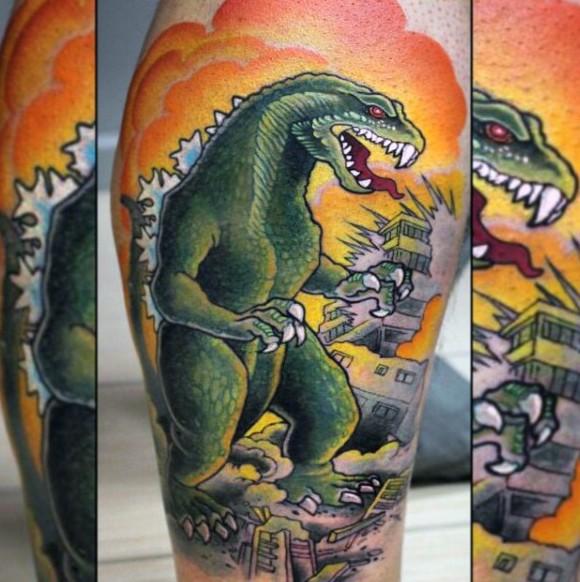 Old cartoon like multicolored Godzilla in city tattoo on leg