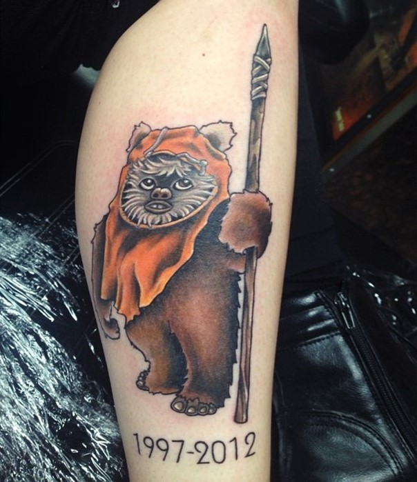 Old cartoon style colored memorial tattoo with little cute hero