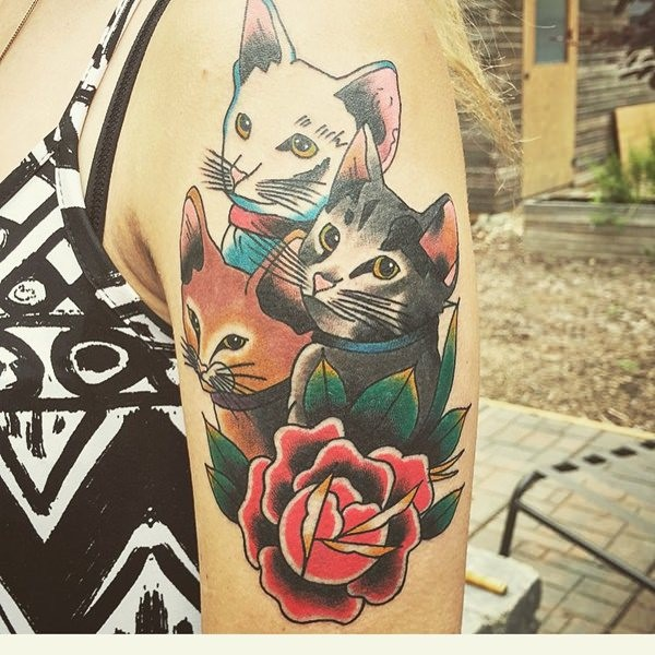 Old cartoon style colored shoulder tattoo of cute kittens with rose