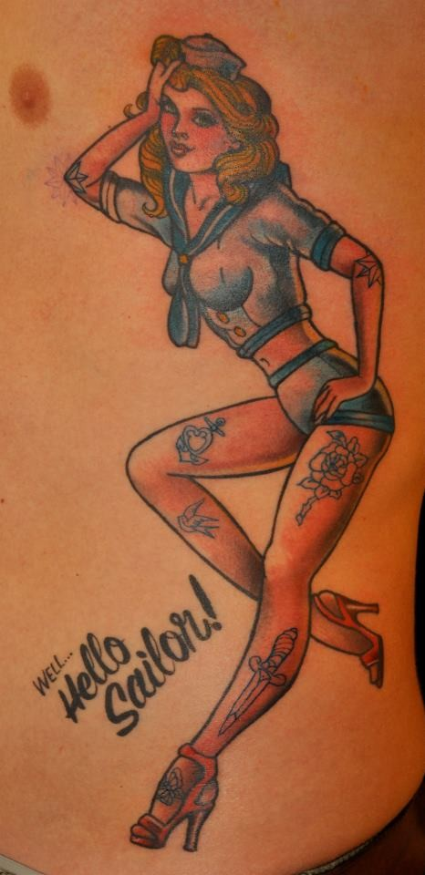 Old cartoon style painted seductive pin up girl tattoo on side