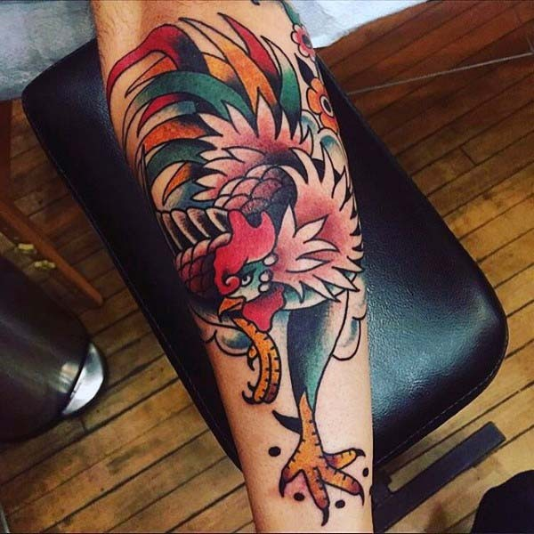 Old cartoons like colored cock with flowers tattoo on leg