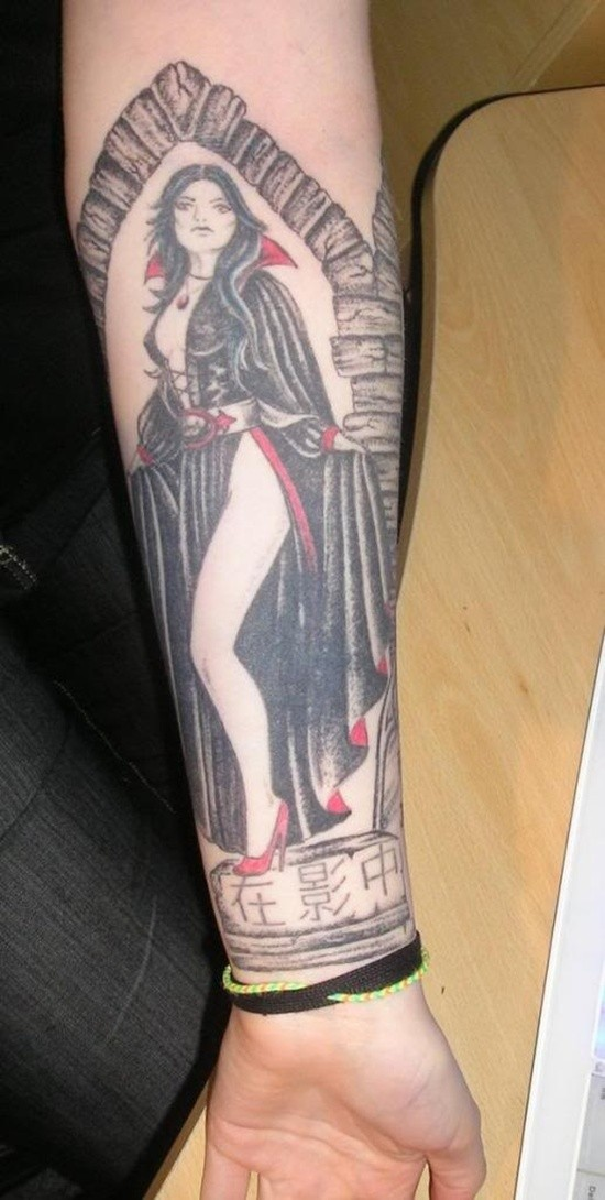 Old cartoons like colored forearm tattoo of seductive vampire woman