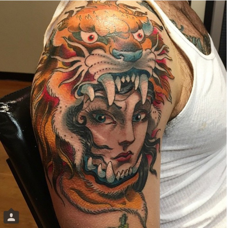 Old cartoons like colored gypsy woman tattoo on shoulder stylized with tiger helmet