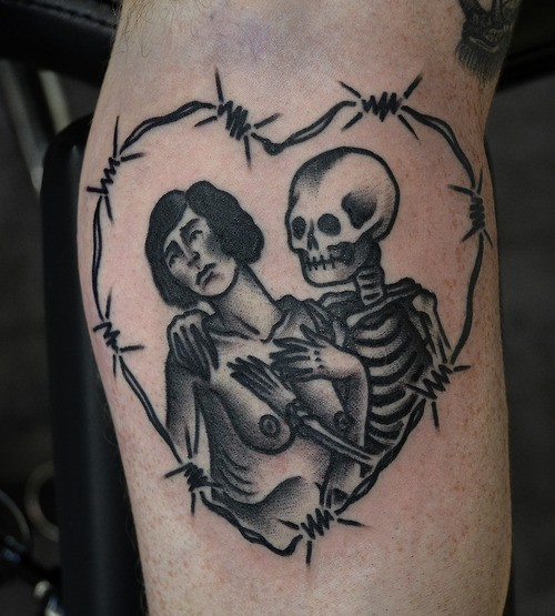 Old cartoons like homemade black ink skeleton with naked woman tattoo on leg