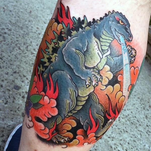 Old cartoons like multicolored Godzilla tattoo on leg