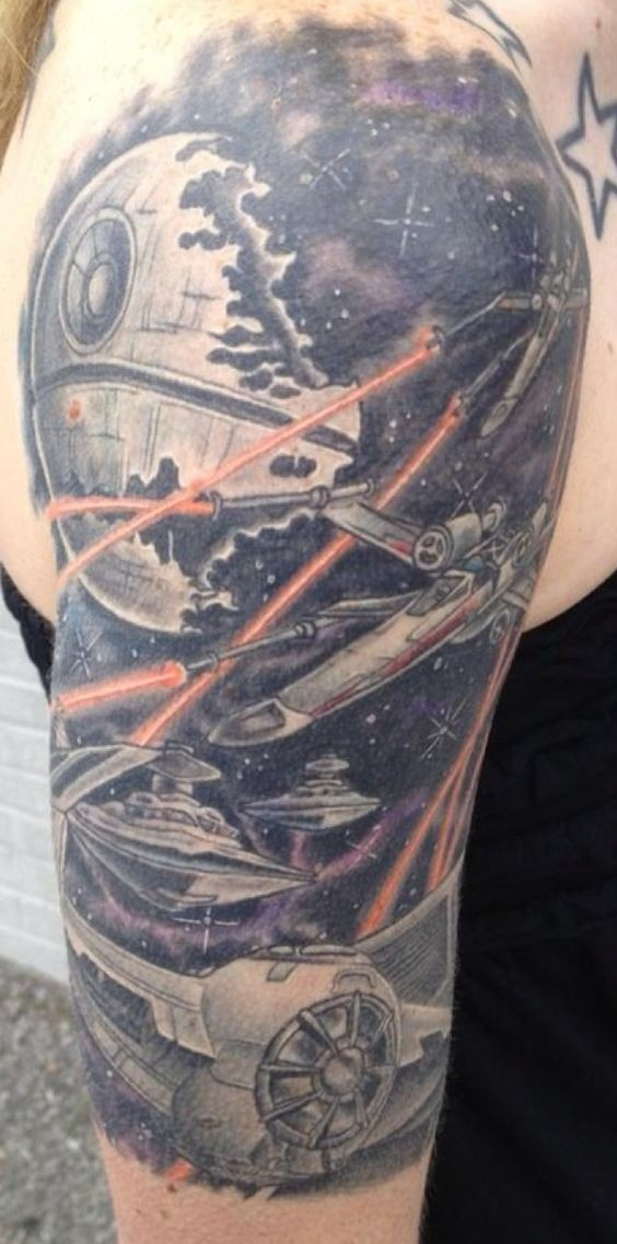 Old cartoons style colored big Star Wars themed on shoulder tattoo