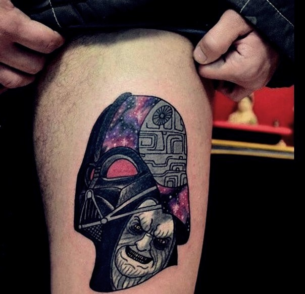 Old Comic books like big Dart Vader tattoo on thigh stylized with Death Star and emperor