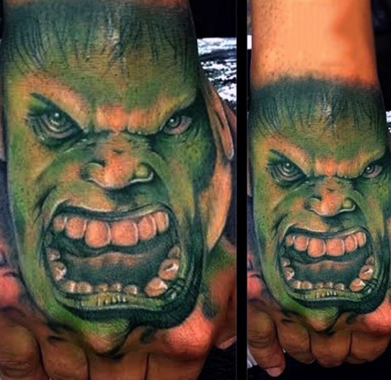 Old comic books themed colored angry Hulk face tattoo on hand