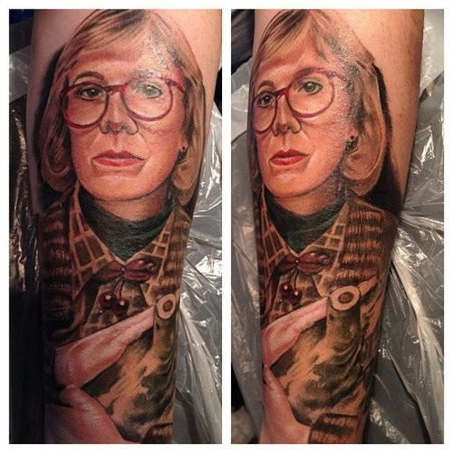 Old fashioned blond middle aged woman in glasses colored portrait tattoo in realism style