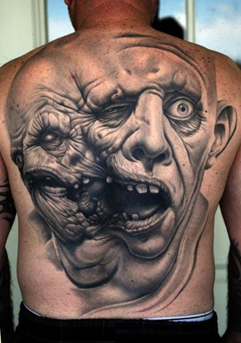 Old horror movie like very detailed colored on whole back tattoo of monster twin-face head