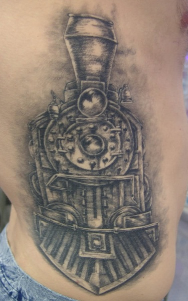 Old looking black ink large train tattoo on side