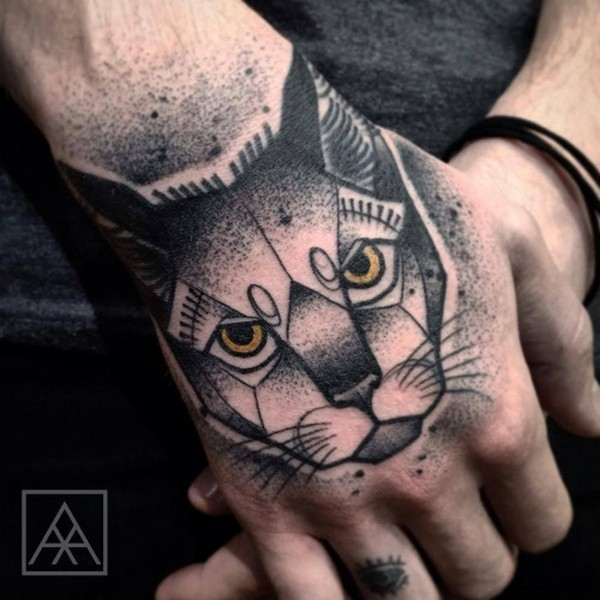 Old looking colored dot style hand tattoo of evil cat head