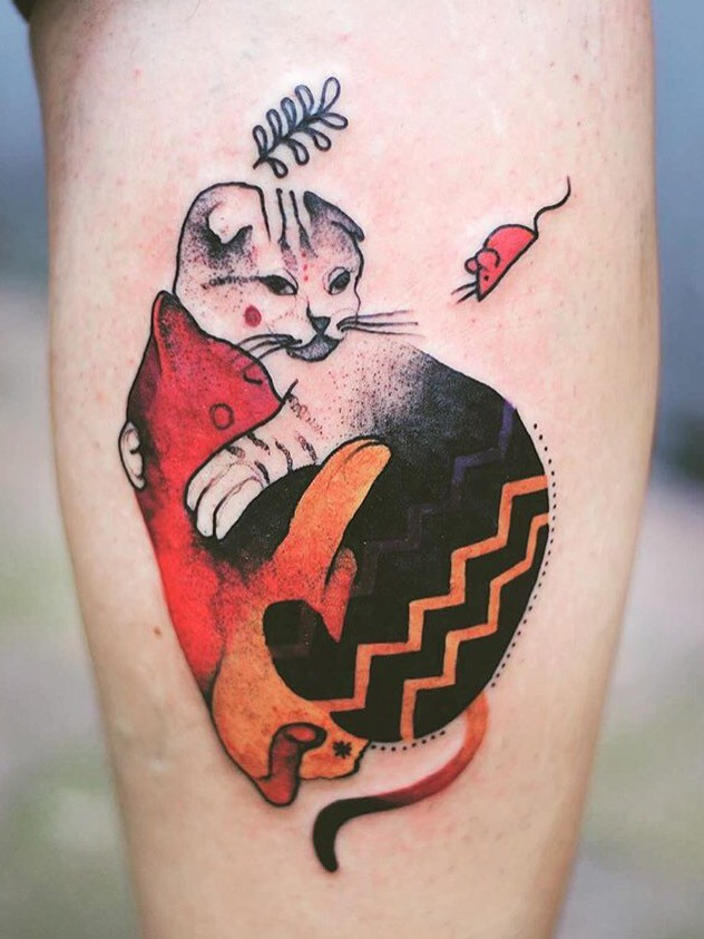 Old looking colored leg tattoo of colored cat by Joanna Swirska
