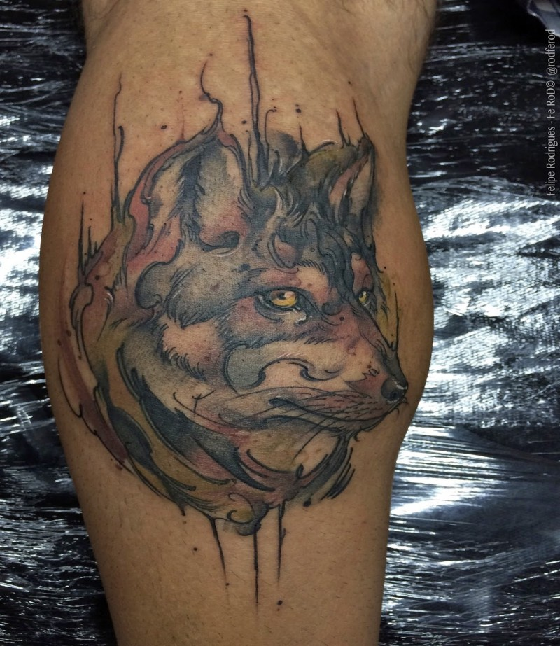 Old looking colored leg tattoo of steady wolf