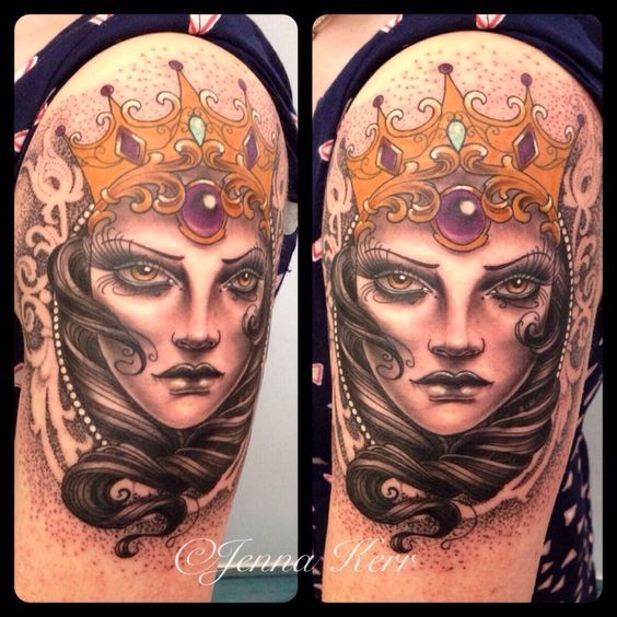 Old looking colored upper arm tattoo of mystical queen with crown by Jenna Kerr