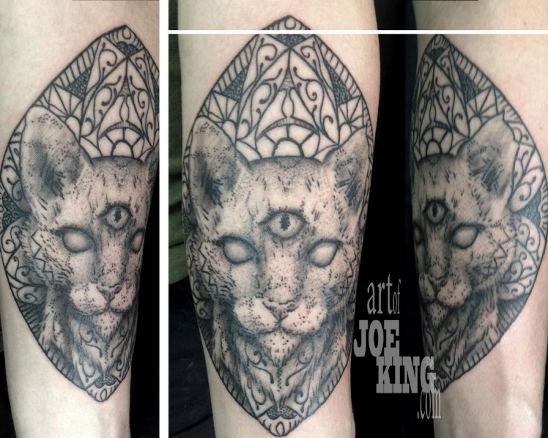 Old looking dot style tattoo of mysterious cat head with ornaments